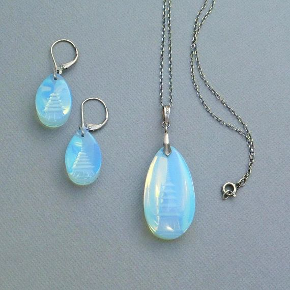Pagoda Etched Into Blue Gemstone Necklace