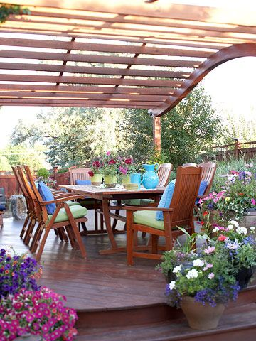 A curved pergola adds a stylish touch to this party-ready patio. More stunning patios: http://www.bhg.com/home-improvement/patio/designs/decks-and-patio-design-ideas/?socsrc=bhgpin070212