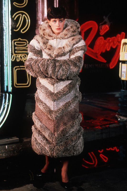 BLADE RUNNER: Sean Young wears a long fur coat of  chevron patterns over her suit. The rarity of fur in the brave new world of 2019 signifies her stature as the assistant to Dr. Eldon Tyrell. She is possibly a different order of replicant and her costumes denote her ability to pass as a human.