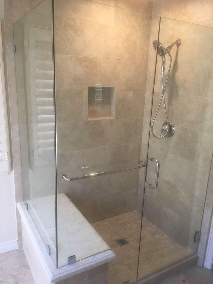 """Master bathroom: Daltile San Michele 'Crema' porcelain tile; Silestone 'LUSSO' solid surface bench. Coordinating wall paint: Farrow and Ball 'Slipper Satin."""""""