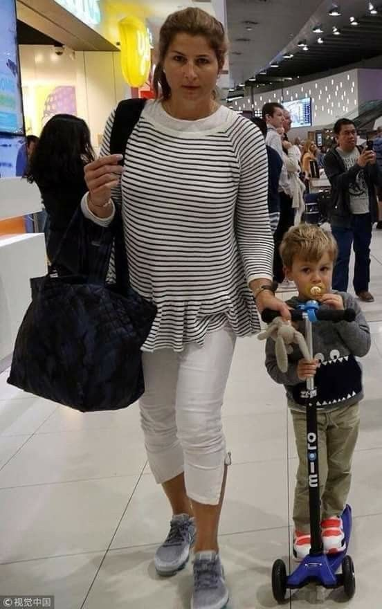 Mirka Federer and son in Perth Airport