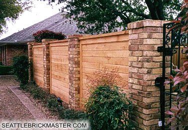 I like the brick posts with the wooden fencing in between.