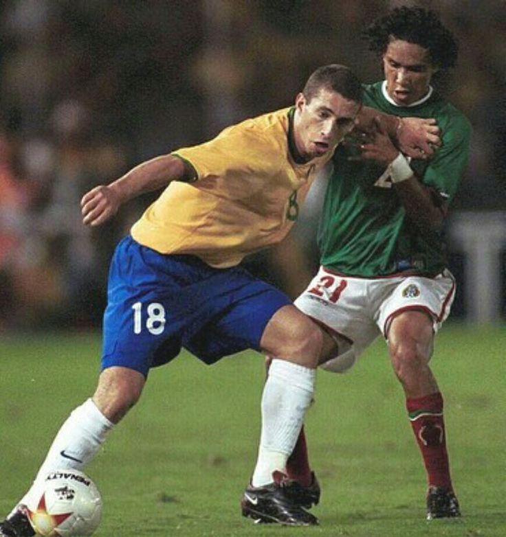 Brazil 0 Mexico 1 in 2001 in Cali. Fabio Rochemback shields the ball from Jesus Arellano in Group B at Copa America.
