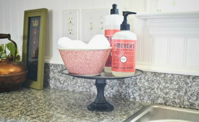 20 Super Smart Ways to Organize Your Kitchen via Brit + Co. (Cake stand for soap--HOW have I never thought of this.)