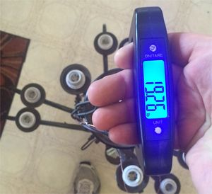 Want to make sure your light fixture isn't too heavy for the chain? Use cheap luggage scale to find out.