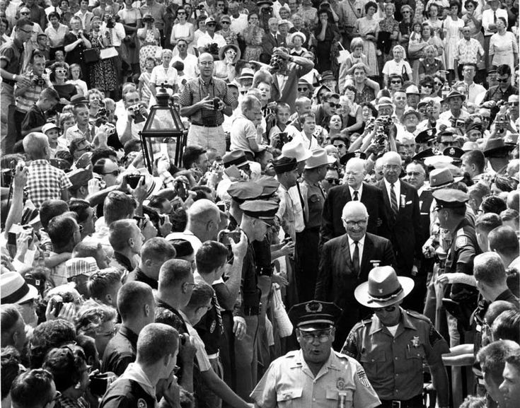 Former Presidents Harry S. Truman and Herbert Hoover move through the crowds of people attending the dedication of the new Hoover Presidential Library and Museum. August 10, 1962. Courtesy of the National Archives...