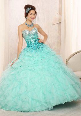Beaded Bodice on a Ruffled Organza Skirt. Matching Bolero Included. Colors Available: Coral, Hot Pink, Light Aqua, White. Quinceanera Dress #88096A