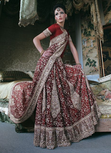 Really awesome red saree, loving the blouse.