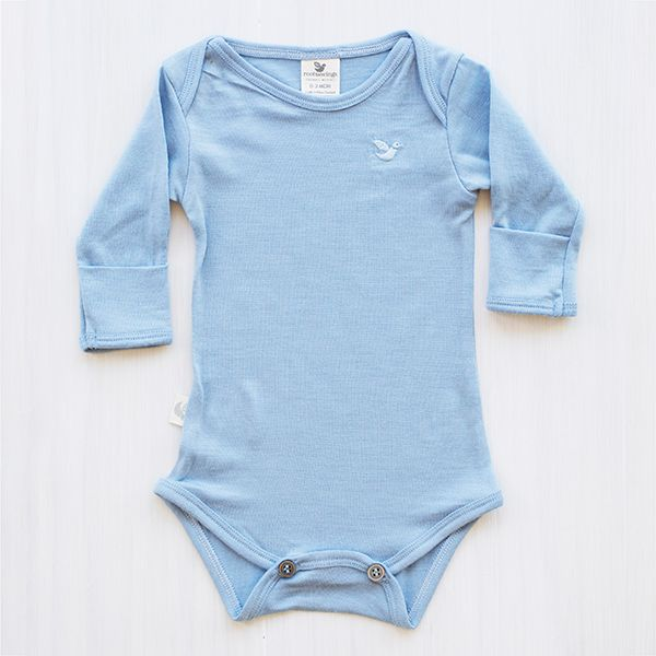 organic merino bodysuit - North Sea blue.  Dive into a sea of softness, we just love the soft base colours. Similar to the North Sea striped bodysuit, this blue colour is perfect on its own or as a warm and temperature regulating inner layer. Bring on those synthetic car seats - the sticky baby backs will be history only.