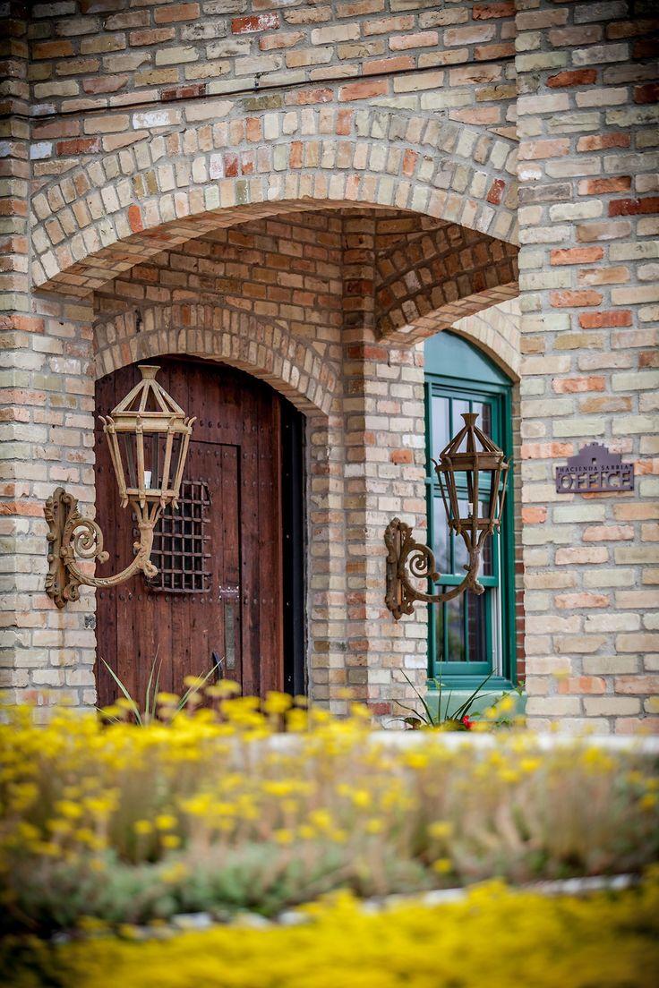 Hacienda Sarria, Gardens in bloom, Brick waslls, Wodden door, Elegant, Beautiful, Yeloow flowers, Kitchener, Waterloo, Cambridge, Ontario, Canada wedding photography experts | Anne Edgar Photography