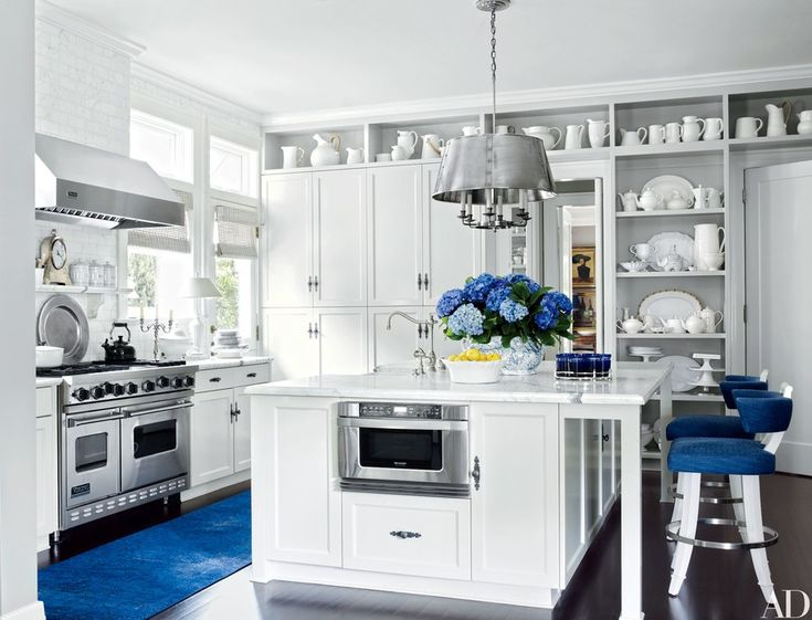 New  home of Dave DeMattei and Patrick Wade uthe couple at the helm of Lucky Brand clothing ua predominately white kitchen is enlivened by pops of royal blue