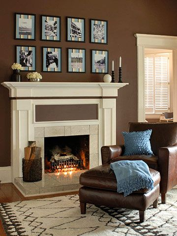 Love the frames:  Fireplace Facelift  Dress up the fireplace by continuing the two-tone look. With its niches and groves painted a rich brown, the fireplace became a graphic element in the room. The mantel decor is kept simple to carry on the clean and chic look.