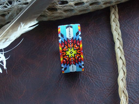 The Starburst This American Indian beaded bracelet with the starburst pattern is made with the blends of the fire colors of the Southwest along with a blue turquoise background by LJ Greywolf. The bra