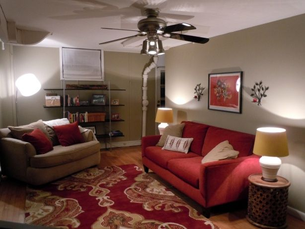 cozy living room with red couch...warm grey wall color!