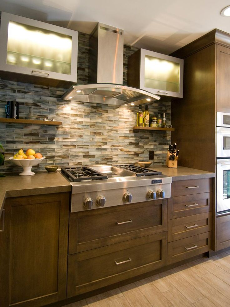 This bold mosaic tile backsplash, open shelving and new appliances make this contemporary kitchen feel up to date. Pale blue tiles offer small pops of color while the brown tiles tie in with the palette in the rest of the room.