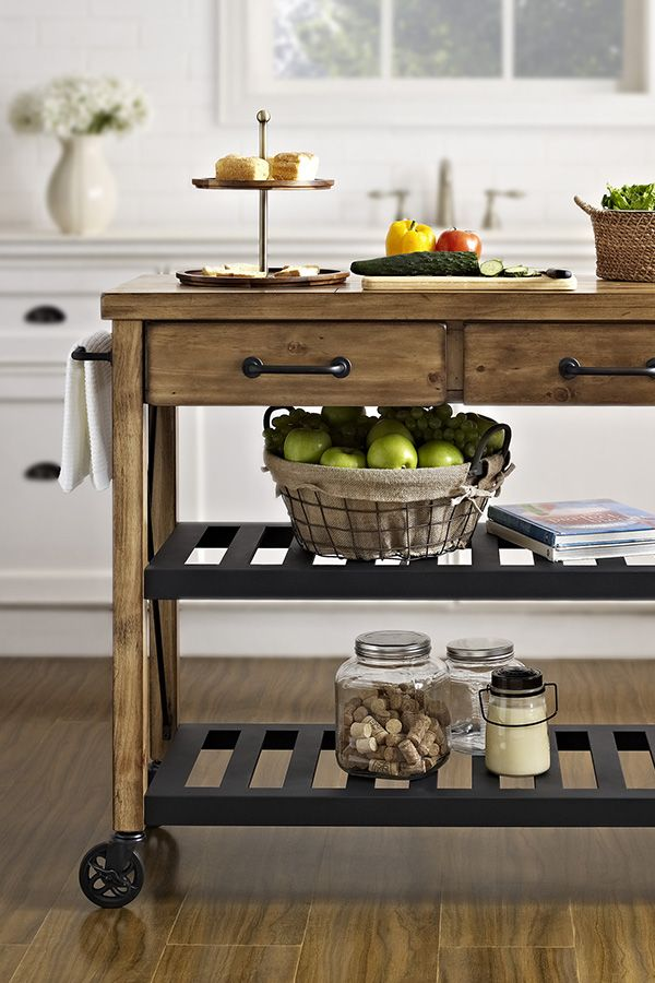 Bring the relaxed style of French wine country to into your home with this rustic kitchen cart. The combination of the reclaimed wood frame and metal shelves make it a perfect match for any rustic, country or industrial style. Click to shop the look at Wayfair!