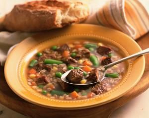 Beef and vegetable soup with spoon and bread - Brian Hagiwara/Photolibrary/Getty Images