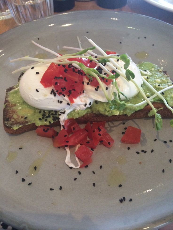 another yummy #breakfast / #brunch with poached #eggs smashed #avocado Persian #fetta diced #tomatoes and nigella seeds served on #glutenfree toast