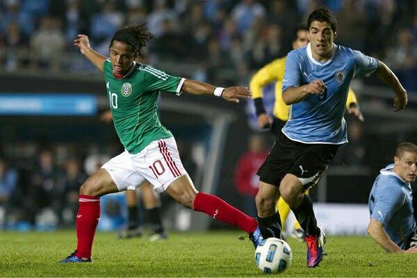 Mexico 0 Uruguay 1 in 2011 in La Plata. Luis Suarez takes on Giovanni dos Santos in Group C at Copa America.