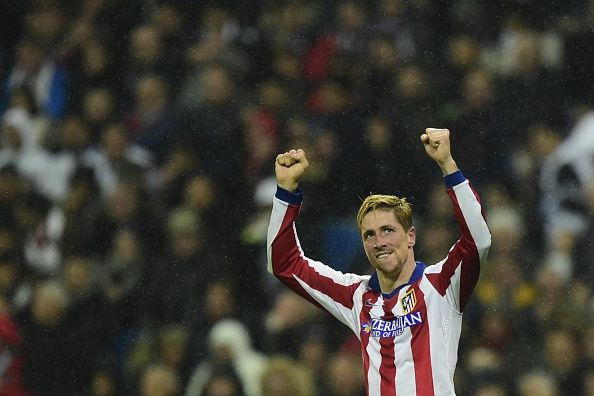 Atletico Madrid's forward Fernando Torres celebrates after scoring his second goal during the Spanish Copa del Rey (King's Cup) round of 16 second leg football match Real Madrid CF vs Club Atletico de Madrid at the Santiago Bernabeu stadium in Madrid on January 15, 2015