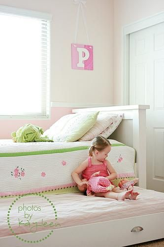 Turn your bed into a trundle bed. Great for extra storage or