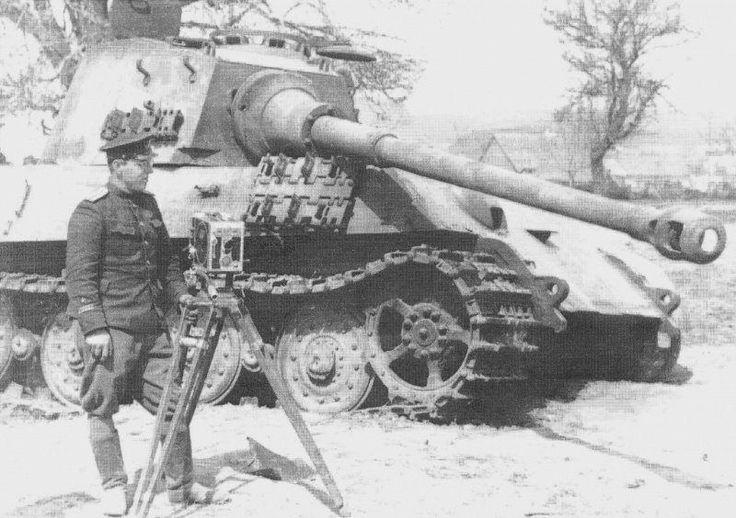 https://flic.kr/p/rjkqUh | Senior Lieutenant Cyril Derevjanko — assistant cameraman Nicholas Prozorovskiy frontline — the languid downed German tank Pz.Kpfw. VI «Tiger II» Balaton during the operation.
