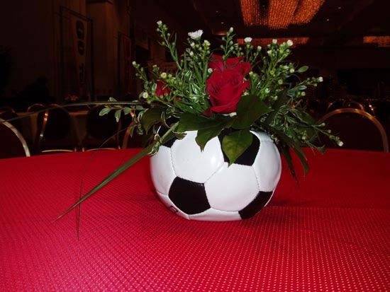 A neat idea for a center piece for soccer banquet.