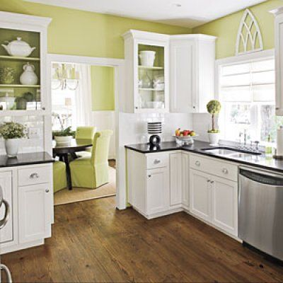 I don't like how clear the glass is on the cabinets, but I do like how they have a mixture of glass and wood doors in the kitchen. I also like the color of the hardwood floors.