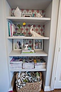 Take off that old closet door, wallpaper back wall with fun pattern and add simple white shelves for a fabulous niche!