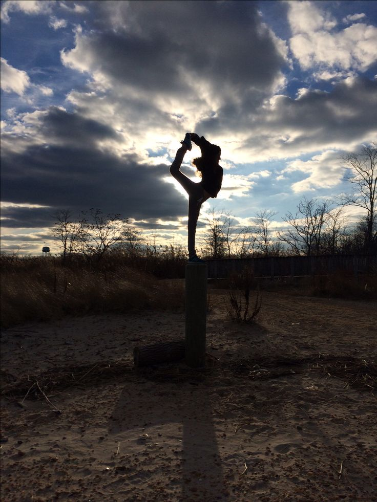 Me doing gymnastics at the beach. It might not be the best but this big log I am on is over 5'4 so it kind of scared me but anyways this is a picture of me. I love gymnastics.