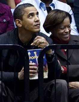 #44thPresident #BarackObama and his mother in law #MarianRobinson watched a basketball game at George Washington University November 28, 2009 in Washington, DC. President Barack Obama attended the game between George Washington University and Oregon State, which was coached by his brother-in-law #CraigRobinson #ObamaFamily #ObamaLegacy #ObamaHistory #ObamaLibrary #ObamaFoundation Obama.Org