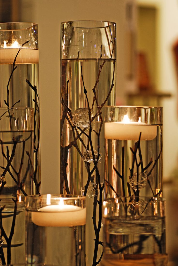 Submerged twigs with floating candles.. what a cheap but beautiful idea!