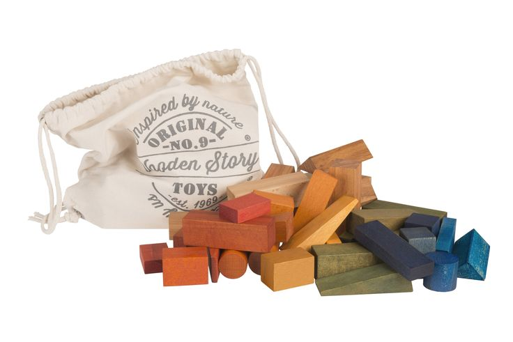 This Wooden Story XL 50-piece rainbow block set comes in a cotton sack. Made from a selection of wood that comes from FSC certified suppliers and tinted with natural pigments to create a rainbow selection of colours, then finished with beeswax and botanical oils, sanded perfectly smooth, soft to the touch. Free of harmful chemicals.  Product eco. Made in the Beskidy Mountains, Poland.