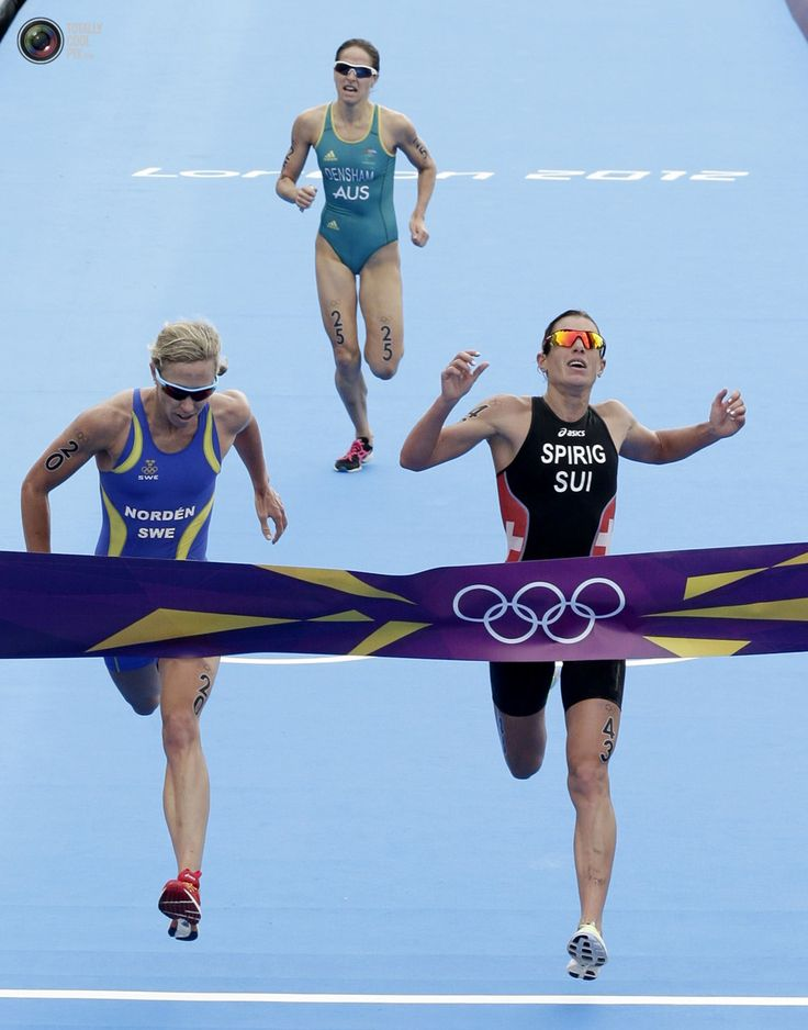 Day 8 - Nicola Spirig of Switzerland wins the women's triathlon final during the London 2012 Olympic Games at Hyde Park. TIM WIMBORNE/REUTERS