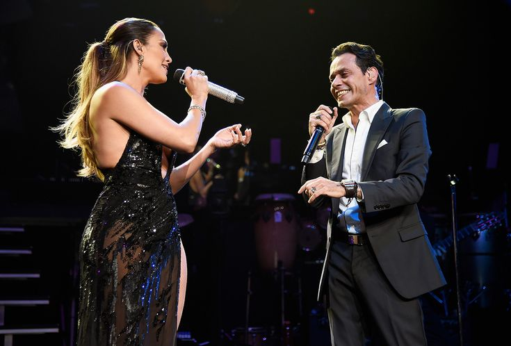 Jennifer Lopez Wows in Sheer Black Gown as She Surprises Marc Anthony Onstage from InStyle.com