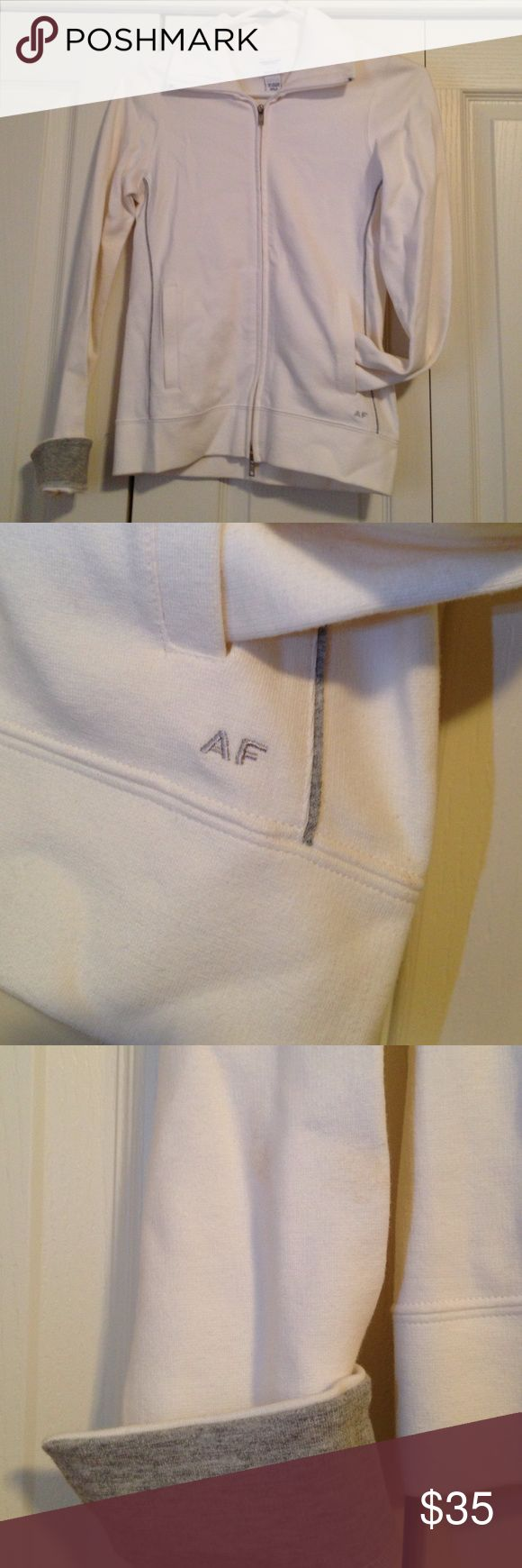 Abercrombie and Fitch jacket Zipper and pockets are fully functional. Worn only once. Very slight stain on the right arm near the wrist as shown in picture. Great condition. Abercrombie & Fitch Jackets & Coats