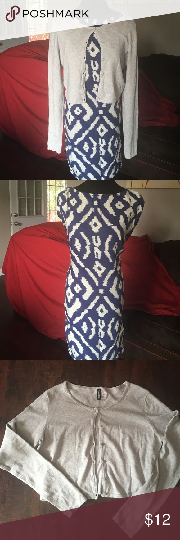 Tribal patterned dress and grey crop cardigan Tribal patterned blue and ivory dress. Grey crop cardigan Thank you for looking. Please remember that NO REASONABLE offer is refused. Happy Poshing ❤️😘🎉😍 Angie Dresses