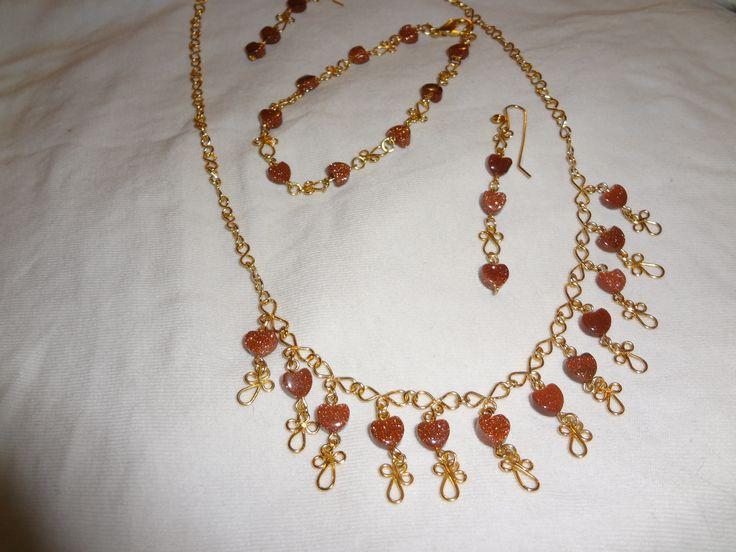collar, pendientes y pulseras lluvia de oro.