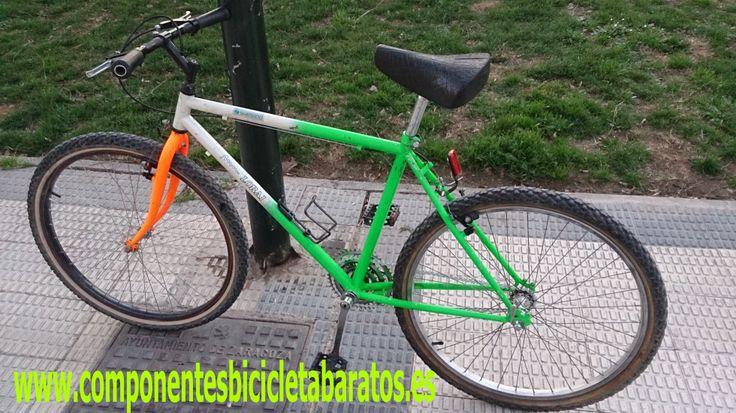 Bicicleta montaña, transformada. Compuesta de cadena taya blanca, piñón libre. Propiedad de componentes bicicleta baratos en Zaragoza.