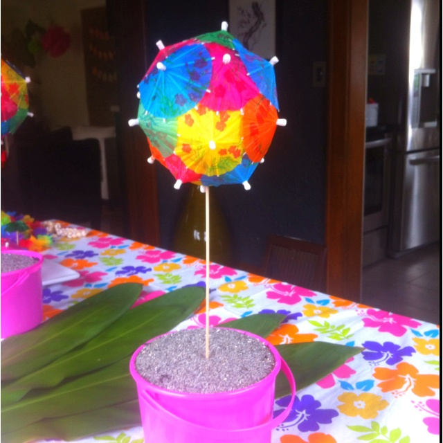 Parasol topiary, beach bucket and table cloth from party city, luau birthday