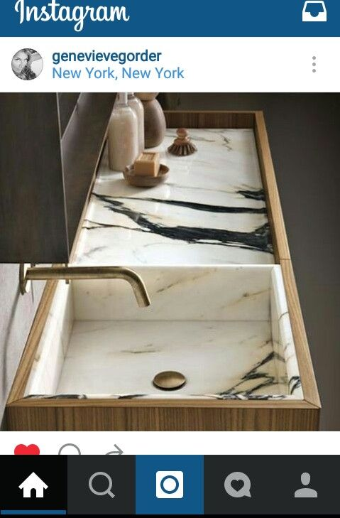 I am swooning over this marble and wood sink from Genevieve Gorder's instagram.