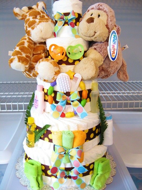 Custom Jungle Safari themed diaper cake for fraternal twins baby shower. Bright colors and safari critters - love it!