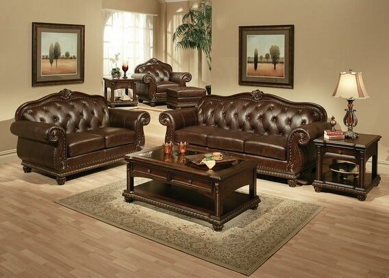 """2 pc Anondale collection cherry finish top grain leather upholstered sofa and love seat with wood trim accents.  This set includes the sofa and love seat with a cherry finish top grain leather upholstery with decorative carving accents and a nail head trim detail and button tufted backs.  Sofa measures 94"""" x 37"""" x 42"""" H.  Love seat measures 66"""" x 37"""" x 42"""" H.  Optional chair and ottoman also available separately and chair measures 47"""" x 37"""" x 42"""" H..."""