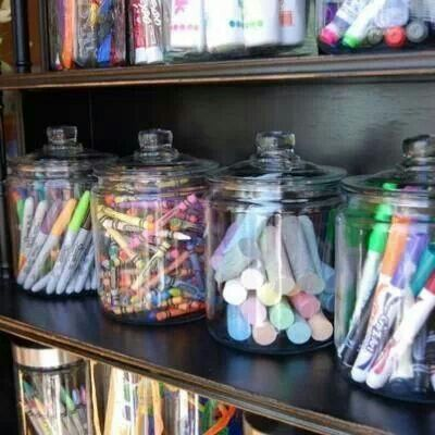 Cute way to store markers, crayons, and chalk. If they are plastic, they are also kid friendly. Much nicer looking than ugly,tearing, card board boxes...