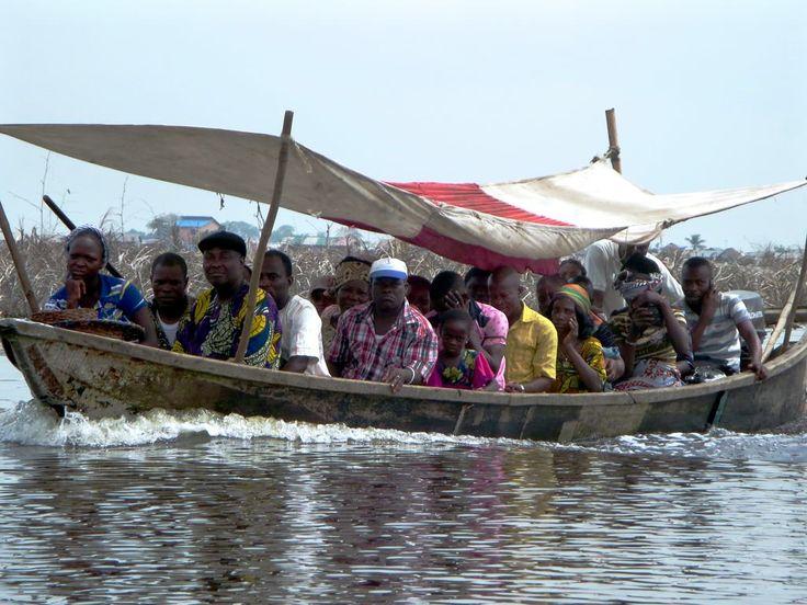 Villagers from Ganvie on Lake Nokoue near Cotonou, Benin, ride toward Abomey Calavi on the mainland.