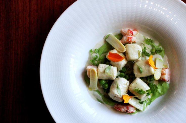 Ricotta gnocchi with white asparagus ragu, green peas, almonds cream and red prawns