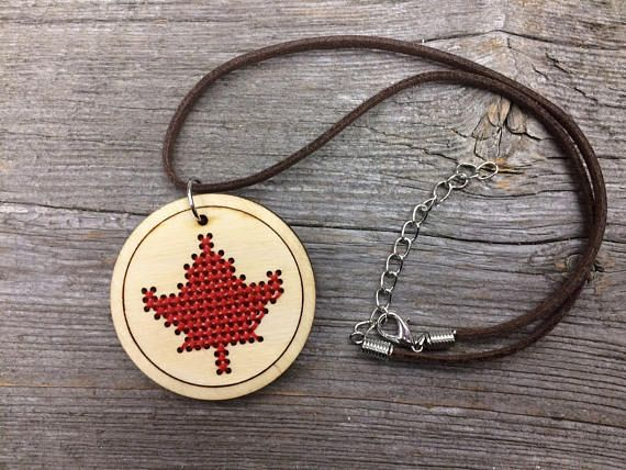 The traditional craft of cross stitching gets a modern twist with this laser cut wood pendant. Each stitch is stitched directly into the wood. This is a great gift in advance of Canadas 150th birthday on July 1, or the perfect accessory to wear yourself!  Each lightweight pendant is laser cut in small batches in Toronto based on my design, and then hand finished in my home studio.  $1 from each necklace sold will benefit The Gord Downie & Chanie Wenjack Fund, which supports cross-cultural...