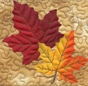 Quilted Leaves ... inspiration, would be so pretty added to plain place mats or table runner ?