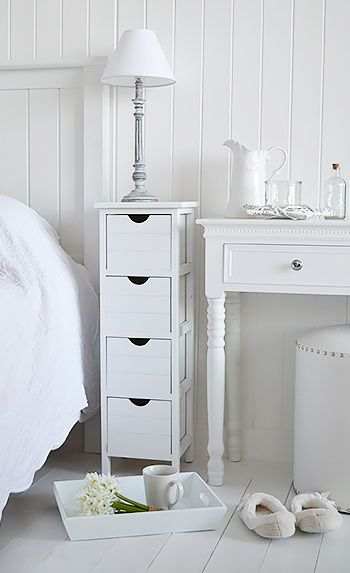 White narrow bedside table with four drawers. Perfect for when there is little space in the bedroom