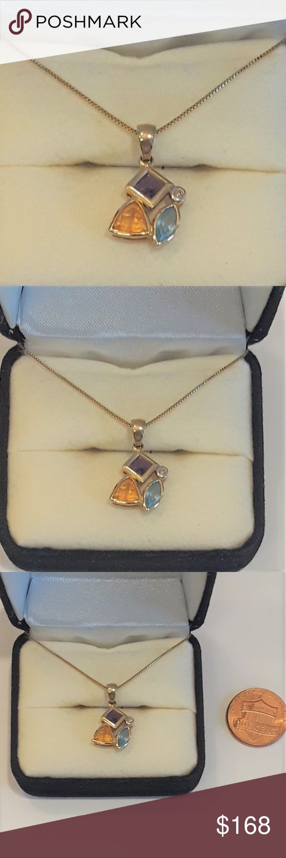 10 K Gold Multi Gemstone Pendant Different shapes of color is fashioned from blue topaz, citrine and amethyst (3/8 ct. t.w.). A round-cut diamond accent sparkles from the top right corner. 10k gold setting.   Chain not included! Jewelry